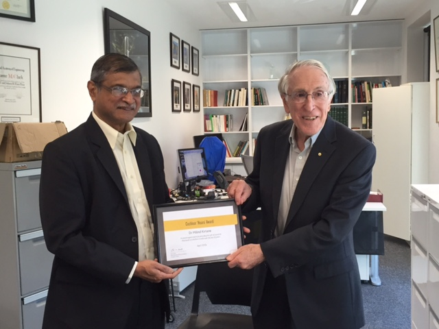 Dr. Milind Kirtane receiving the Cochlear Hearo Award from Dr Graeme Clark, the pioneer of Cochlear Implants in Sydney, Australia